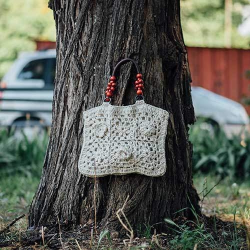 Boutique hand knitted ladies bag made of natural cotton with wooden handles and linen lining 100% handmade